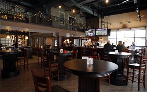The McQuearys uncluttered the bar area, removing sports attire and some of the televisions that were added in the Admiral's American Grill era.