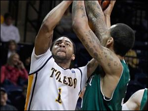 Toledo's Dominque Buckley is closely guarded by Chicago State's Jeremy Robinson.