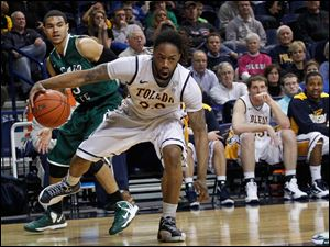 Rockets player Reese Holliday dribbles in front of Chicago State's Clarke Rosenberg.