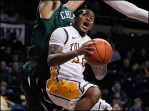 Toledo's Julius Brown moves to the basket as he is defended by Chicago State players during game at Savage Hall Monday.