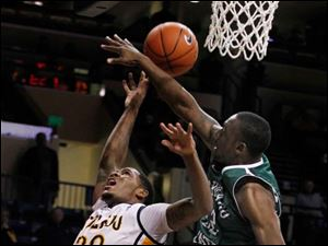 Toledo player Julius Brown has his shot is blocked by Chicago State's Nate Duhon.