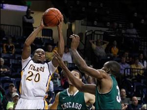 Toledo's Julius Brown shoots over Chicago State's Clarke Rosenberg (35) and Quinton Pippen during Monday's game.