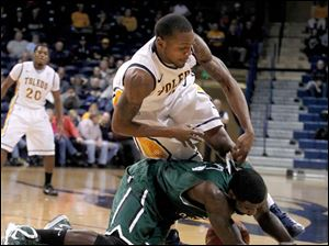 Toledo's Rian Pearson and Chicago State's Quinton Pippen scramble for a loose ball.