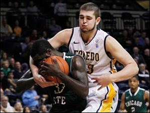 Chicago State's Quinton Pippen is intentionally fouled by UT's Nathan Boothe near end of the game.