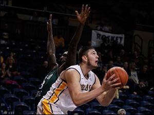 Chicago State's Quinton Pippen lets Toledos' Nathan Boothe get around him in Savage Arena.