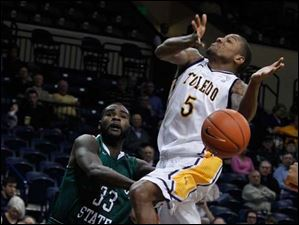 Chicago State's Quinton Pippen fouls UT's Rian Peason on a drive to the basket.