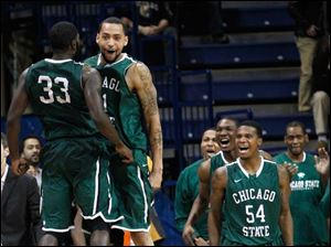 Chicago State's Quinton Pippen (33) and Jeremy Robinson celebrate their 58-53 victory over the Toledo Rockets.