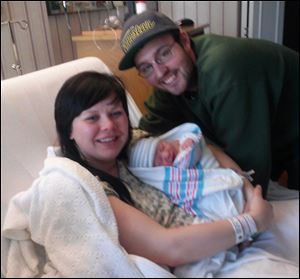 Proud parents Britney Spoldt and Dan Poulin hold the Toledo area's first baby of 2013 Eli John. Eli was born at Flower Hospital in Sylvania at 1:28 a.m.