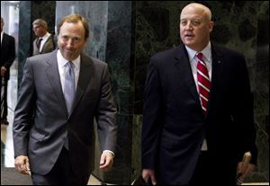 NHL commissioner Gary Bettman, left, and Bill Daly, deputy commissioner and chief legal officer, following collective bargaining talks in Toronto.