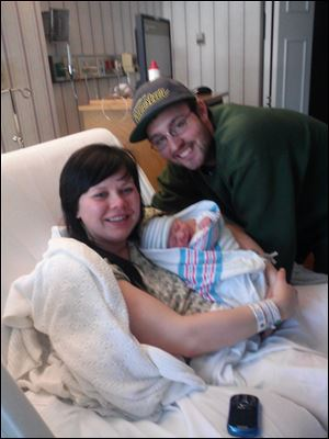 Proud parents Brittany Spoldt and Dan Poulin hold the Toledo area's first baby of 2013 Eli John. Eli was born at Flower Hospital in Sylvania at 1:28 a.m.