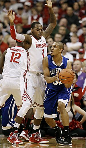 Ohio State's Deshaun Thomas defends UNC-Asheville's Will Weeks. OSU is seeking to find a second scoring option after Thomas.