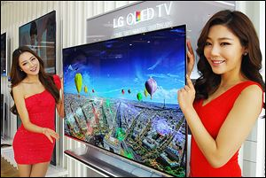 LG Electronics has begun taking pre-orders on 55-inch TVs that use ad­vanced en­ergy-ef­fi­cient dis­play tech­nol­ogy. LG's model is just 4 mil­li­me­ters thick — or less than one-sixth of an inch.