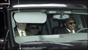 Secretary of State Hillary Clinton, center, is transported on the New York Presbyterian Hospital complex in New York.
