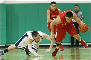 Bedford's Dennis Guss steals the ball from Lakota's Nathan Ray. Guss, a 5-11 senior, averages 9.6 points per game.