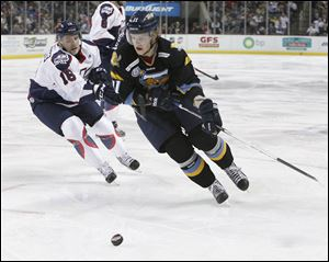 Walleye player Andrej Nestrasil takes the puck past Kalamazoo's Joe Charlebois during a game last month.