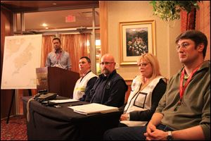 Shell Oil incident commander Susan Childs, second from right, answers a question about the Monday night grounding of the Shell drill ship Kulluk at a press conference at the Mariott Hotel in Anchorage, Alaska.