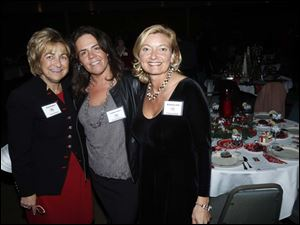 Kim Kaplan, left, event co-chair, Tammy Holder, executive director, and Katrina Iott, event co-chair, pose for a picture.