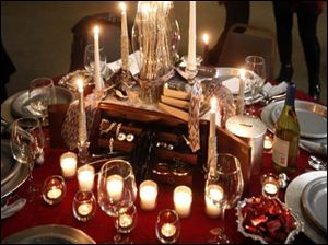 A table with christmas decorations is displayed during the Beach House Christmas by Candlelight.