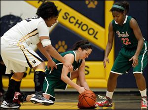 Central Catholic's Jen Vliet (14) beats teammate Jasmine Scott and Whitmer's Keshyra McCarver to chase down a loose ball.