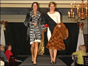 (L-R)  Rebecca Shope and Kristen Mollenkoft, both wearing Sophie's Sister and Toledo Furs.
