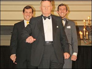 (L-R)  MIB (Men in Black)  Dock Treece, Bill Puckett and Ben Treece model the seasons hottest trends in tuxedos from President Tuxedo.
