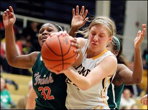 Central Catholic's Deonna Murdock battles Whitmer's Jordyn Blood for a rebound.