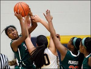 Central Catholic's Jasmine Scott pulls in a rebound against Whitmer's Abigial Sarabia (40).