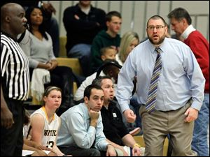 Whitmer head coach Sean Flemmings reacts to a call during the game.