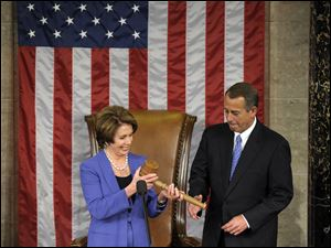 House Minority Leader Nancy Pelosi of Calif. passes the gavel today to House Speaker John Boehner of Ohio, who was re-elected as House Speaker of the 113th Congress.
