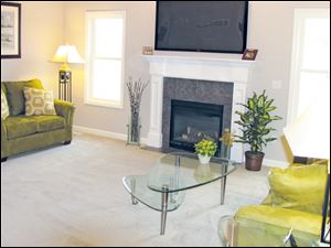 The sunny great room is highlighted by a cozy fireplace, which lights at the flick of a switch.