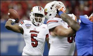Louisville quarterback Teddy Bridgewater was 20 of 32 passing for 266 yards and two touchdowns against the heavily favored Gators..