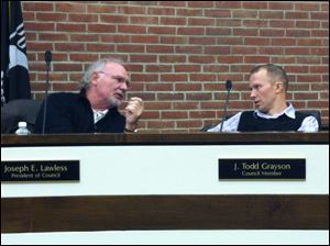 Perrysburg City Council president Joseph Lawless, left, speaks with councilman J. Todd Grayson prior to Wednesday's council meeting.