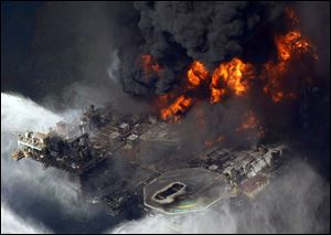 A scene in April, 2010 of the Deepwater Horizon oil rig burning in the Gulf of Mexico. Transocean Ltd. owned the drilling rig.