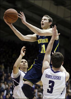 Michigan guard Nik Stauskas had 10 points in the game.