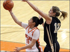 Bowling Green State University's Katrina Salinas takes the ball to the hoop in front of  UCF's Kayli Keough.