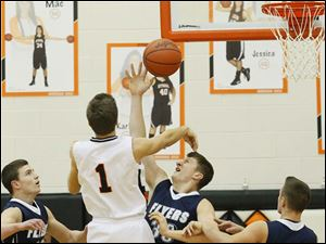 Lake's junior Jayce Vancena (33) blocks Otsego's senior Tommy Rodgers (1).