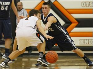 Lake's sophomore Connor Bowen (32) attempts to steal the ball from Otsego's senior Tommy Rodgers (1).