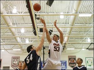 SPT otsegobhoops04p Otsego's senior A.C. Limes (53) puts up two points over Lake's senior Marcus Pierce (54).