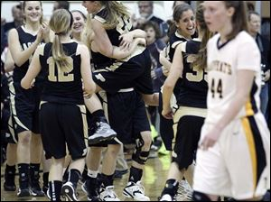 Perrysburg celebrates defeating  Sylvania Northview 53-49 in double overtime.