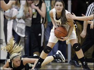 Sylvania Northview's Kendall Jessing (54) steals the ball from Perrysburg's Abby Sattler (10).