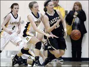 Perrysburg's Maddy Williams (12) is fouled by Sylvania Northview's Lauren Keil (30).
