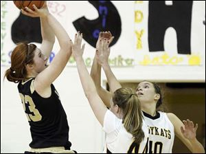 Perrysburg's Sarah Baer (23) takes a shot against Sylvania Northview's Maddie Cole (44) and Kendall McCoy (40).