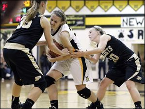 Perrysburg's Allex Brown (35) and Abby Sattler (10) battle Sylvania Northview's Lauren Yurjevic (32).