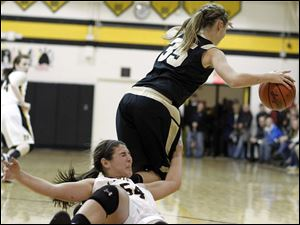 Perrysburg's Allex Brown (35) steals the ball from  Sylvania Northview's Kendall Jessing (54).