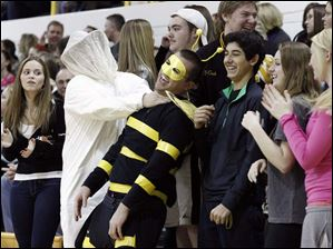 Perrysburg's fans celebrate a win over Sylvania Northview.