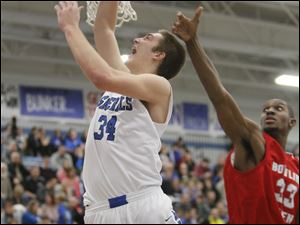 Anthony Wayne High School player Mark Donnal, 34, puts up a shot past Bowling Green High School player Vito Brown, 33.