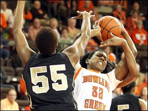 Bowling Green State University's Alexis Rogers fights for the rebound from UCF's Erika Jones.