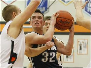 Lake's sophomore Connor Bowen drives the lane for a layup.