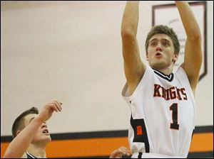 Otsego's senior Tommy Rodgers, (1) puts up two points over Lake's sophomore Connor Bowen (32).