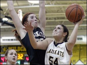 Perrysburg's Sarah Baer (23) defends against Sylvania Northview's Kendall Jessing (54).